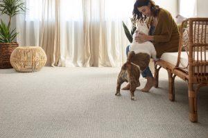Lady with dog on Carpet floor | Frazee Carpet & Flooring