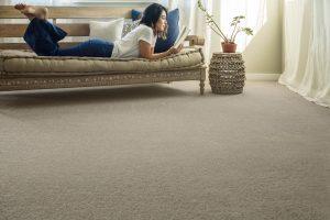 Lady reading book | Frazee Carpet & Flooring